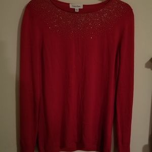 Red sweater size Large. CALVIN KLEIN